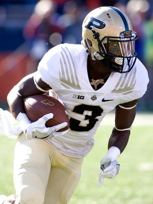 Purdue wide receiver Bilal Marshall (3) carries the ball against Illinois during the second quarter of the Boilermakers' 34-31 overtime victory at Memorial Stadium.