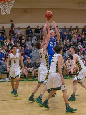 Carson's  Tez Allen shoots over Bishop Manogue's Johnny Reiley at Manogue on Friday.