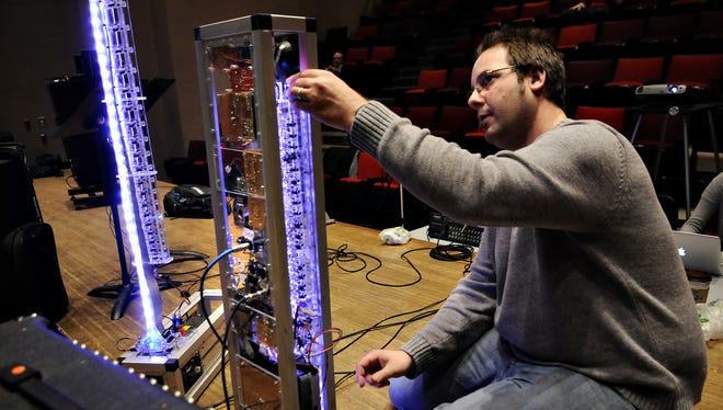 """Troy Rogers starts MARIE, a monochord aerophone robotic instrument ensemble, for the show """"Man & Machine"""" in February 2012 in the Performing Arts Center at St. Cloud State University."""