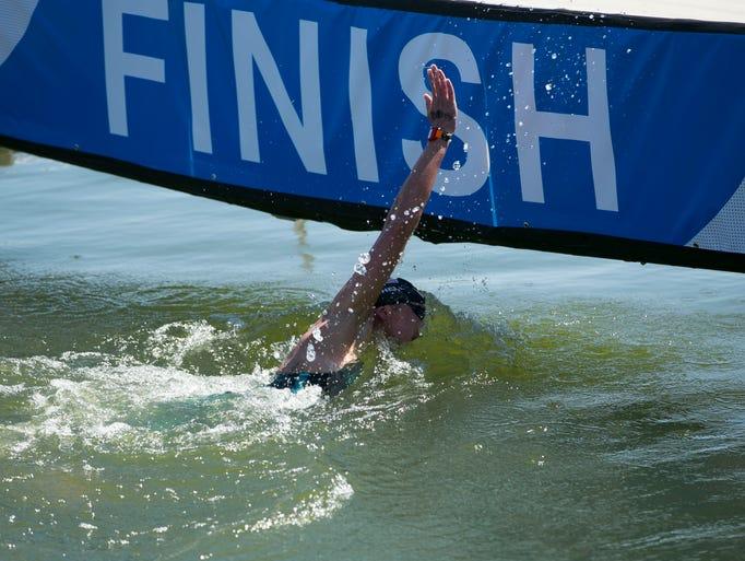 Ashley Twichell slaps the finish board winning the