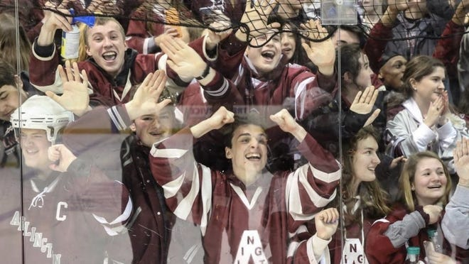 Arlington fans celebrate after the Division 1A Super 8 boys hockey winner's bracket game against Pope Francis at Loring Arena in Framingham, Mar. 7, 2020. The Spy Ponders beat the Cardinals, 2-1.