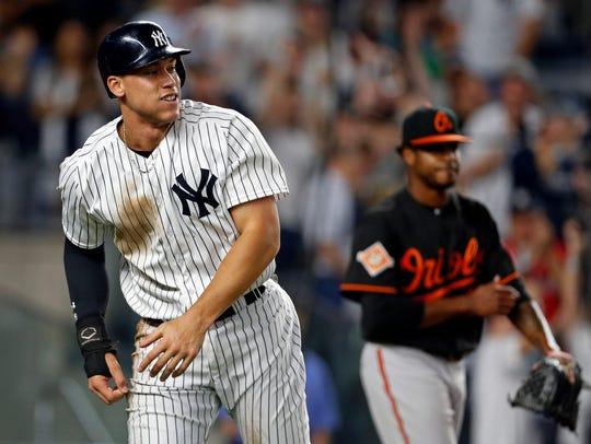 Yankees right fielder Aaron Judge (99) reacts in front