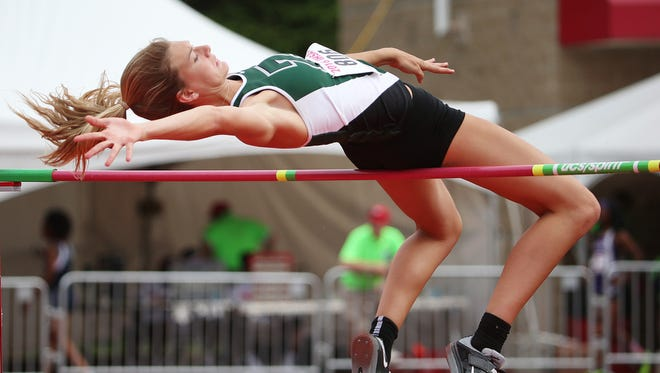 Katie Isenbarger is first in the state in the high jump at 5 feet 11 ½ inches, breaking a 35-year-old Zionsville school record.