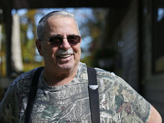 Lake Delhi resident Steve Crowley stands outside of his home on Lake Delhi on October 9, 2015, in rural Delaware County. Crowley's home on the lake has been in his family for three generations.