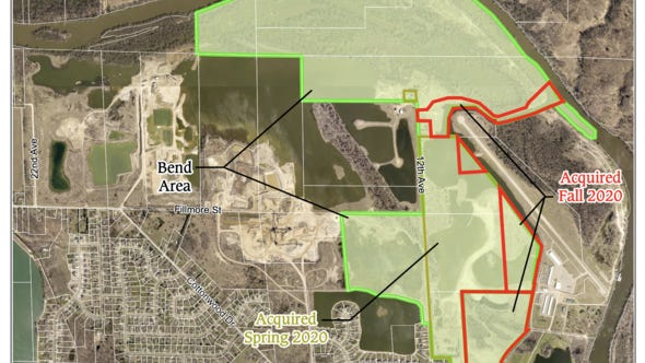 A map shows 62 acres of land acquired in October by the Ottawa County Parks Department to grow the footprint of the Bend Area Open Space, which is being developed into a park.
