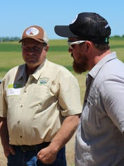 Greg Blatz (right) made the decision to take over his family's Fond du Lac County organic dairy farm from his father, Ken in January 2019.
