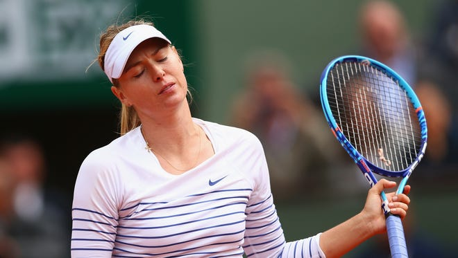 Maria Sharapova of Russia reacts in her  loss against Lucie Safarova of Czech Repbulic on day nine of the 2015 French Open at Roland Garros on June 1, 2015 in Paris.