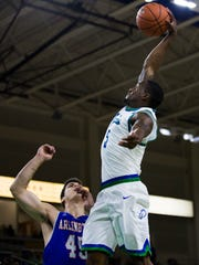 Florida Gulf Coast University redshirt sophomore, Zach Johnson, dunks the ball as University of Texas at Arlington senior, Jorge Bilbao, attempts to block during the men's basketball home opener at Alico Arena in Fort Myers on Wednesday, November 16, 2016. Florida Gulf Coast University won the game against University of Texas at Arlington, 85 to 72.