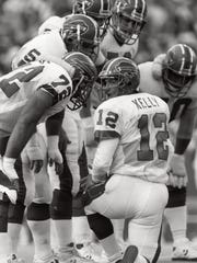 Jim Kelly in the huddle during his first game with the Buffalo Bills against the New York Jets, Sept. 7, 1986.