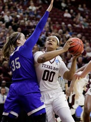 Texas A&M's Khaalia Hillsman (00) looks to shoot as
