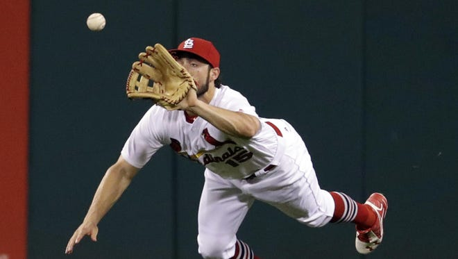 Cardinals center fielder Randal Grichuk dives to catch a ball hit by the Athletics' Stephen Vogt to end the top of the fifth inning Friday night in St. Louis.