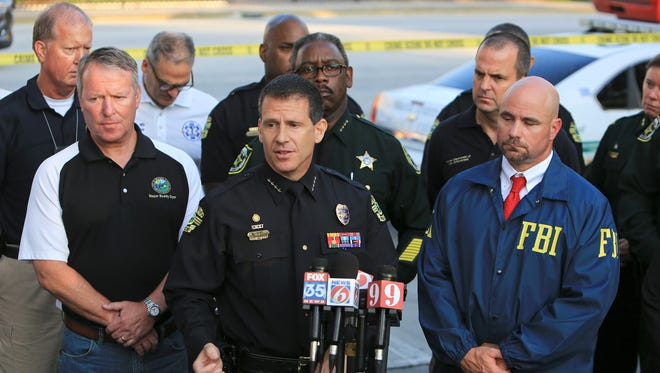 Orlando Police Chief John Mina, center, speaks during a press conference Sunday regarding the Orlando Pulse nightclub shooting. A gunman wielding an assault-type rifle and a handgun opened fire inside a crowded gay nightclub early Sunday, killing at least 50 people before dying in a gunfight with SWAT officers, police said. It was the worst mass shooting in American history.