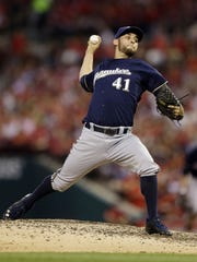 In this Aug. 2, 2014, file photo, Milwaukee Brewers starting pitcher Marco Estrada throws during the sixth inning of a baseball game against the St. Louis Cardinals in St. Louis. Adam  Lind was traded from the Toronto Blue Jays to the Brewers on Saturday, Nov. 1, 2014, for Estrada.