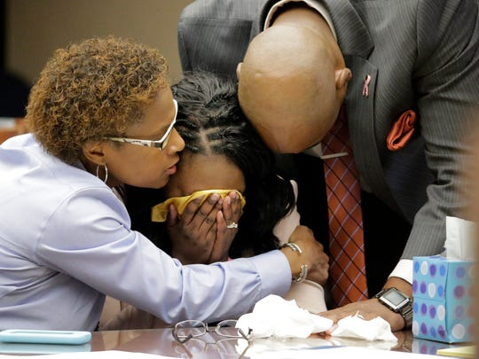Wakesha Ives, 39, center, is comforted by her husband, right, and former pastor, left, during a break while waiting to be sentenced in 2015 after 22 character witnesses gave statements on her behalf. After the 15-minute break, Ives received a six-month suspended jail sentence and two years of probation from 384th District Judge Patrick Garcia. Ives was found guilty by a jury Sept. 19, 2015, in the death of her daughter, Janay Aliah Ives.