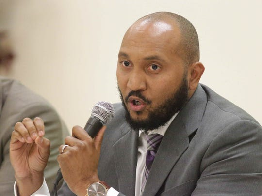 Pannel member and Senior Pastor of Light of the World Christian Church and Deputy Mayor for the City of Indianapolis, Dr. David Hampton speaks during a community conversation with elected officials on racial tension, held at New Beginnings Fellowship Church, Thursday August 4th, 2016.