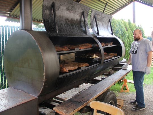 Roger Schneider of Roger That BBQ smokes his brisket for 18 hours. Employees spend the night at the restaurant to watch the smoker.