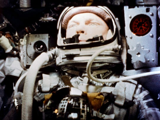 "Astronaut John Glenn pilots the ""Friendship 7"" Mercury spacecraft during his historic flight as the first American to orbit the Earth."