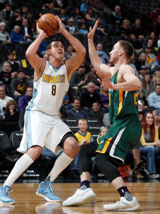 Denver Nuggets forward Danilo Gallinari looks to shoot over Utah Jazz forward Gordon Hayward during the first half of an NBA basketball game Tuesday, Jan. 24, 2017, in Denver. (AP Photo/David Zalubowski)