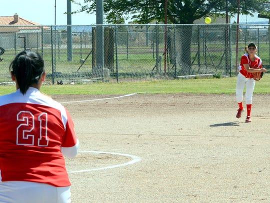 Loving junior shortstop Leliana Rodriguez throws to