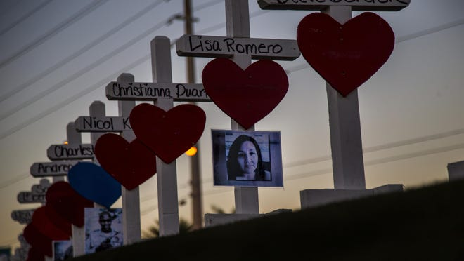 Wooden crosses bearing the names of those killed during Sunday's mass shooting line the median near the Welcome to Las Vegas sign off Las Vegas Boulevard on October 5, 2017 in Las Vegas, Nevada. Greg Zanis of Illinois drove all night to deliver the homemade crosses.(Gina Ferazzi / Los Angeles Times/TNS)