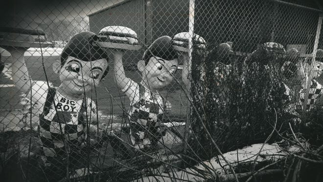 Discarded Big Boy statues stand in storage behind Marcus Restaurants' headquarters at State and 63rd streets in this photo, published in The Milwaukee Journal March 29, 1989.
