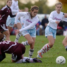 Madeline Kelly of Lincoln steps over Roosevelt's Abigail Behm as Kelly and Kamryn Miller chase the ball last fall during the state high school girls soccer championships at Yankton Trail Park. Lincoln and Roosevelt both are considered contenders for a state title. <factbox_bold>INSIDE:</factbox_bold> Class A and B girls preview: <factbox_bold>3D</factbox_bold>