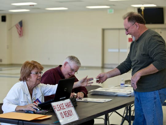 Election Officials Annette Duffy and Bob Sheehy prepare
