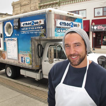 In this 2012 photos, Greg Lee of Sheboygan stands in front of his truck where he sells Greek food. Lee is opening a brick-and-mortar location in Sheboygan