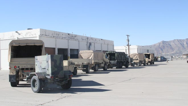 Soldiers line up vehicles and equipment for turn in at Fort Bliss' consolidated yard during Divestiture Week. Equipment like vehicles, radios and generators were turned in to fill shortages across the Army.