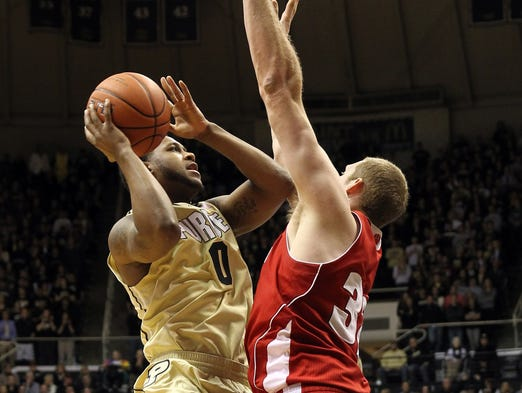 Purdue Boilermakers guard Terone Johnson (0) shoots over Wisconsin Badgers center Evan Anderson (32) during the first half at Mackey Arena. Mandatory Credit: Pat Lovell-USA TODAY Sports