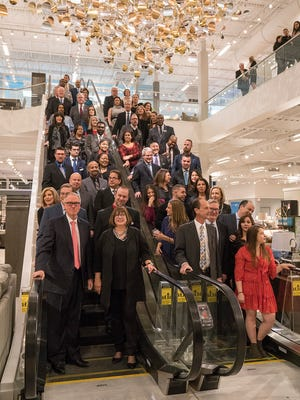 Art Van execs and famiies gather for a group photo on the escalator.