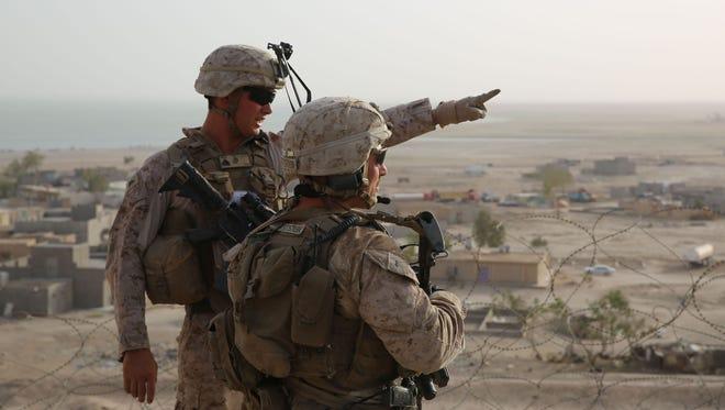 U.S. Marines patrol at Al Taqaddum Air Base, Iraq, last year.