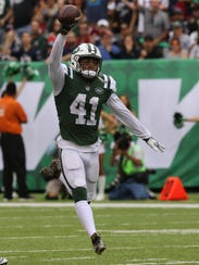 Buster Skrine after intercepting a Tom Brady pass in
