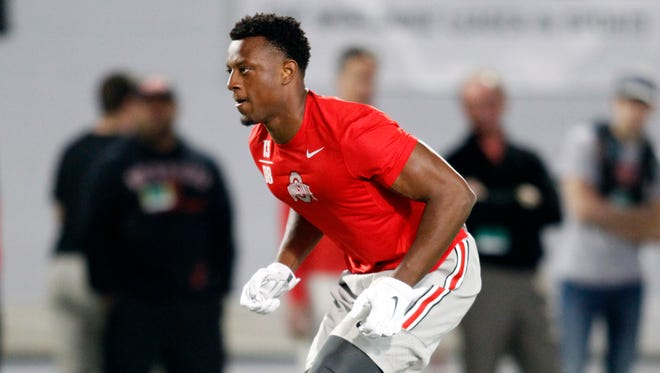 Ohio State defensive end Eli Apple runs a drill during NFL Pro Day at Ohio State University in Columbus, Ohio, Friday, March 11, 2016.