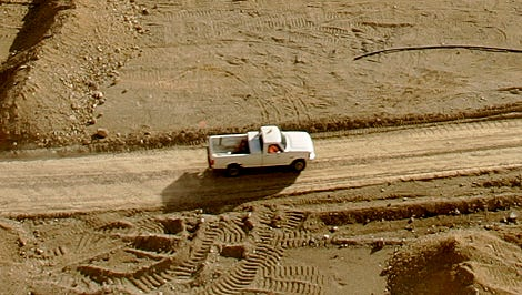 A pickup truck drives into the 600-foot deep mine at Barrick's Ruby Hill gold mine outside Eureka in 2006. The company's Nevada taxes could rise if a ballot measure is passed by voters next month.