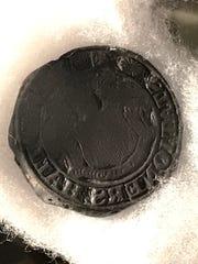 A coin bearing the seal of David Felt's company, Station