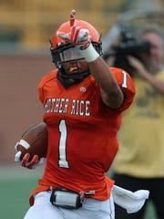 Birmingham Brother Rice's Grant Perry scores a touchdown in the Prep Kickoff Classic in August 2014. Perry is part of Michigan's freshman class.