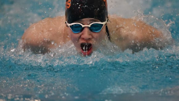 Hudson Tritter competes in 100 yards buterfly at the