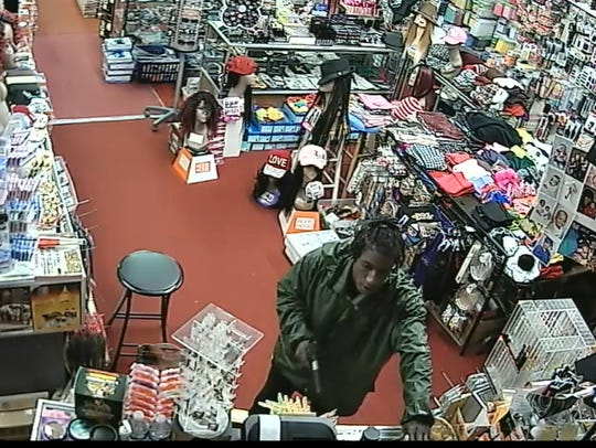 Surveillance photo of robbery suspect