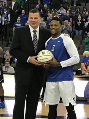 Marcus Foster of Wichita Falls recently scored his 1,000th career point as a NCAA Division I player. He received a personalized basketball for the honor. Also picture is Creighton head coach Greg McDermott.