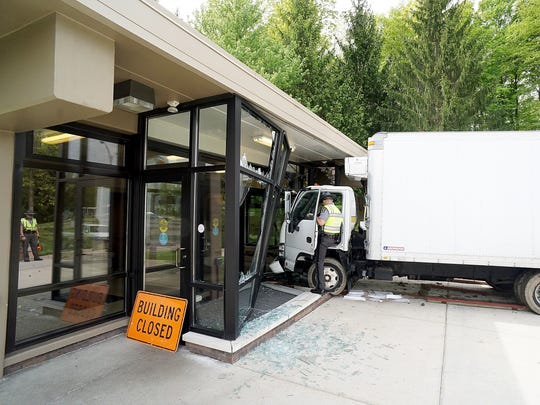 A driver of a white box truck crashed through the front of the rest stop building on the eastbound side of Ohio 30 on Friday morning.