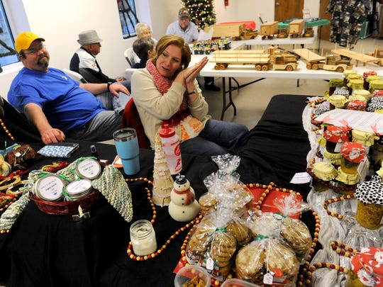 Vicki Larimore sits among the jellies, baked goods, and other homemade items she was selling during the third-annual Christmas Craft Sale Dec. 2, 2016. Held at First United Methodist Church in Cross Plains, the sale was sponsored by the Cross Plains Public Library and featured crafts from local residents.
