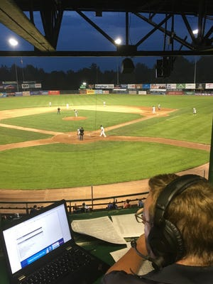 Broadcaster Rich Haskell watches the action from the press box as the Vermont Lake Monsters face the Connecticut Tigers on Wednesday night at Centennial Field.