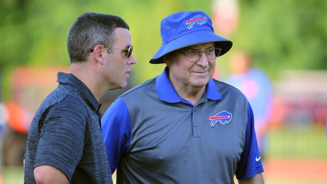 Bills owner Terry Pegula, right, is impressed with 'thoroughness' of GM Brandon Beane's work.