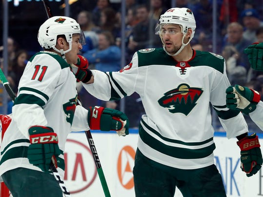 Minnesota Wild's Zach Parise, left, is congratulated by Nino Niederreiter, of Switzerland, after scoring during the third period of an NHL hockey game against the St. Louis Blues Tuesday, Feb. 6, 2018, in St. Louis. The Wild won 6-2. (AP Photo/Jeff Roberson)