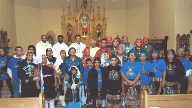Rev. Rogelio Martinez with PMT pueblo members andmatachines from Butterfield Park.