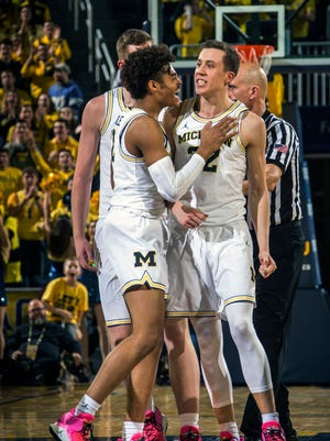 Duncan Robinson, right, after making a 3-pointer in the second half against Iowa on Wednesday.