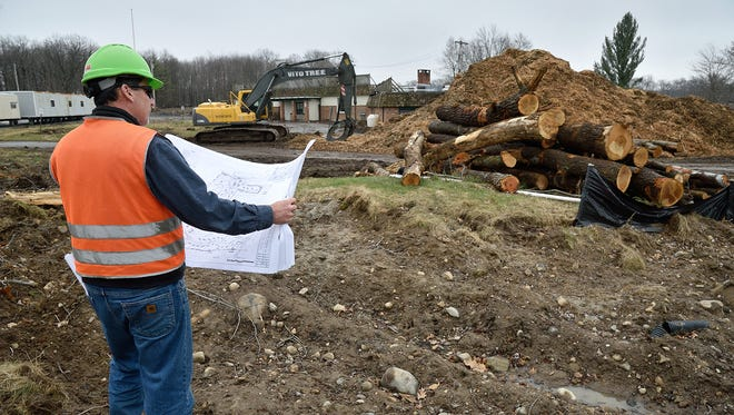 A field supervisor for Toll Brothers Home Builders checks the site plans at the development site of the old High Mountain Golf Club in Franklin Lakes in March.