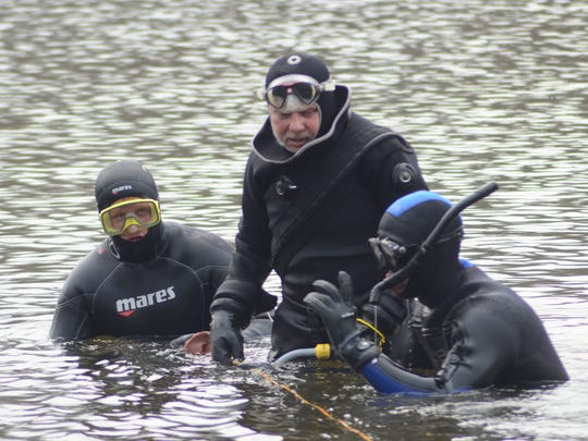 Divers searched the Kalamazoo River on Friday, April
