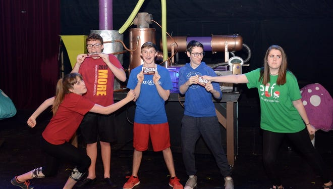 "Golden Ticket winners, from left, are Veruca Salt (Caitlen Richison), Augustus Gloop (Aidan Neely), Charlie Bucket (Chase Shaw), Mike Teavee (Cadence LeBoeuf) and Violet Beauregarde (Sydney Wisdom) in the Wichita Theatre's production of ""Willy Wonka."""
